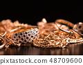 Gold jewelry closeup. 48709600