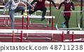 Hurdlers racing in cold and hitting hurdles 48711238