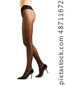 Perfect woman's legs in pantyhose  48711672