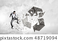 Man destructing recycle symbol 48719094