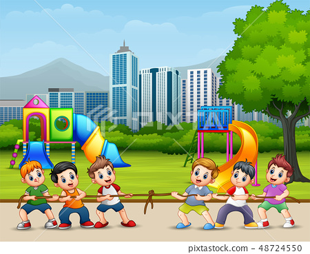 Happy Children playing tug of war in the city park 48724550