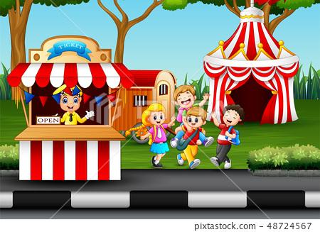Happy kids having fun in an amusement park 48724567
