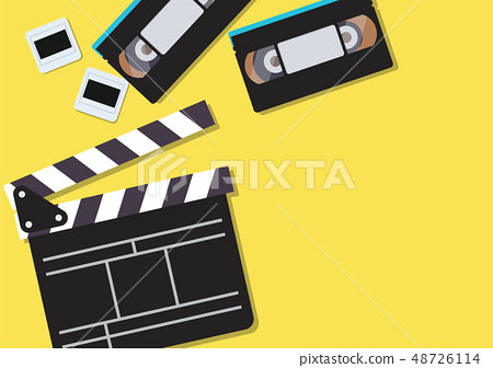 Movie clapper and video cassette tapes on yellow 48726114
