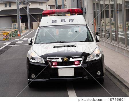 A patrol car at a stop 48726694