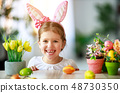 Happy easter! funny child girl with rabbit ears 48730350
