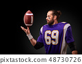 american football player throwing ball on black background 48730726
