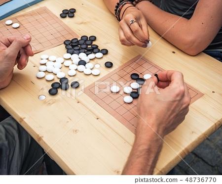 People playing chinese boardgame. People Playing Mahjong Asian Tile-based Game. Table Gambling top 48736770