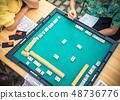 People Playing Mahjong Asian Tile-based Game. Table Gambling top view 48736776