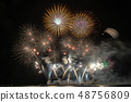 Fantastic Multicolor Firework exploding for Celebration from the big boat over the sea, celebration and happy new year and merry christmas concept 48756809
