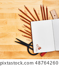 Blank notepad over school and office supplies 48764260