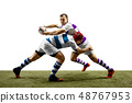 The silhouette of two caucasian rugby male players isolated on white background 48767953