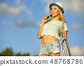 Portrait of happy hipster girl on sky background 48768786