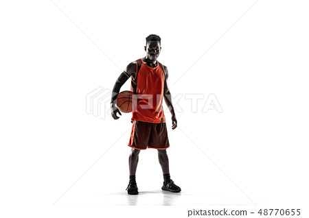 Full length portrait of a basketball player with ball 48770655