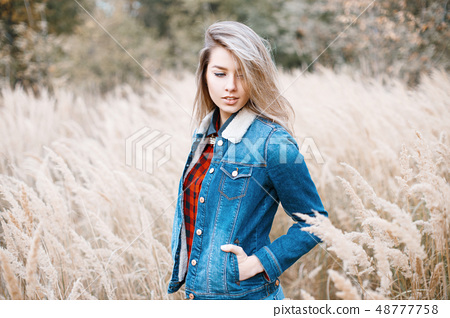 Young girl in jeans clothes  48777758