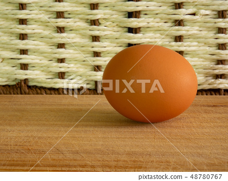Brown eggs of light color prepare for the holiday Easter against the background from a white rope 48780767