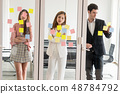 Unhappy business people standing in office. 48784792