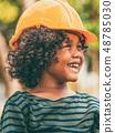 Happy little boy engineer wearing helmet hard hat. 48785030