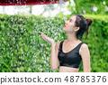 Woman taking shower at swimming pool in resort. 48785376