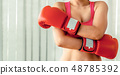 Boxer woman does boxing sport in fitness gym. 48785392