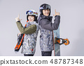 Friendship or couple's leisure concept, young couple enjoy dating, snowboarding and skiing in winter season.238 48787348