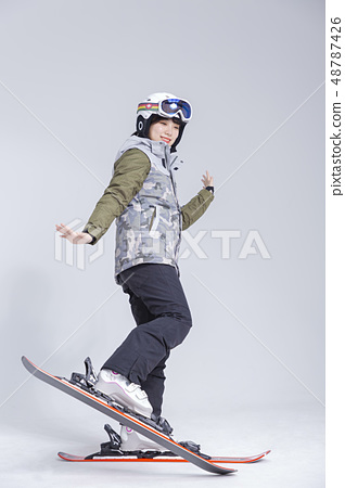 Friendship or couple's leisure concept, young couple enjoy dating, snowboarding and skiing in winter season. 168 48787426
