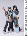 Friendship or couple's leisure concept, young couple enjoy dating, snowboarding and skiing in winter season.235 48787512