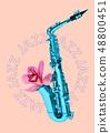 Blue saxophone on pink background 48800451