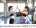 Two young beautiful woman touching hand in gym 48801270