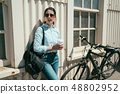 Beauty with vintage bike with white wall 48802952