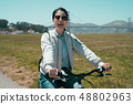 positive happy girl ride bicycle in park 48802963