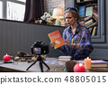 Pleasant young woman speaking about an interesting book 48805015