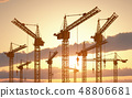 Construction cranes at sunset 48806681