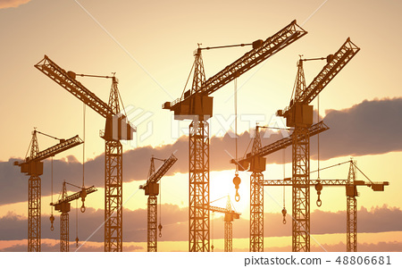 Construction cranes at sunset 48806681