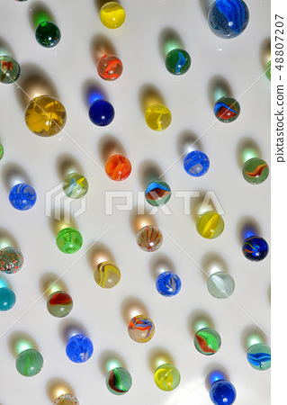 Glass marble balls and shadows 48807207