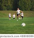 little happy children on football field 48808086