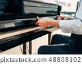 Pianist opens the keyboard lid of grand piano 48808102