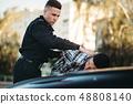 Police officer arrests the driver violator on road 48808140