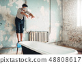 Businessman in flippers dives into the bathtub 48808617