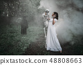 Victim with human skeleton and death in the forest 48808663