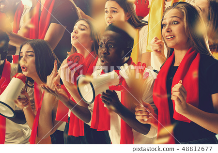 Group of happy fans are cheering for their team victory. 48812677