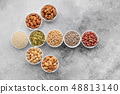 Assortment of nuts in white saucers  48813140