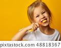 Adorable girl brushing teeth with kids toothbrush 48818367