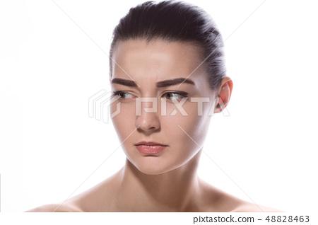 Portrait of beautiful young sad woman 48828463