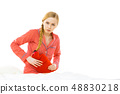 Woman feeling stomach cramps lying on bed 48830218