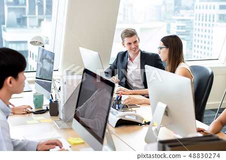Group of business people coworkers working in 48830274