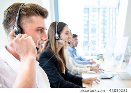 Smiling friendly man working in call center office 48830281