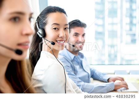 Smiling beautiful Asian woman working in call 48830295