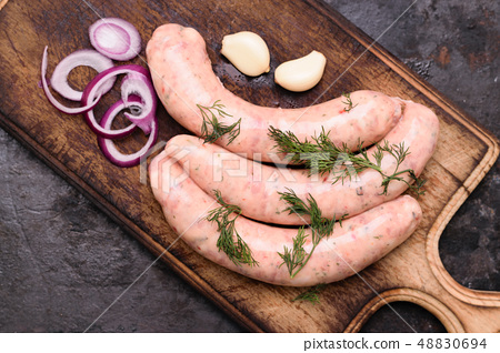 Cooking raw sausages 48830694