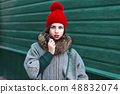 Retro portrait of a beautiful girl in a red hat 48832074