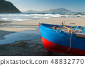 Boat on the pier and ischia island in background 48832770